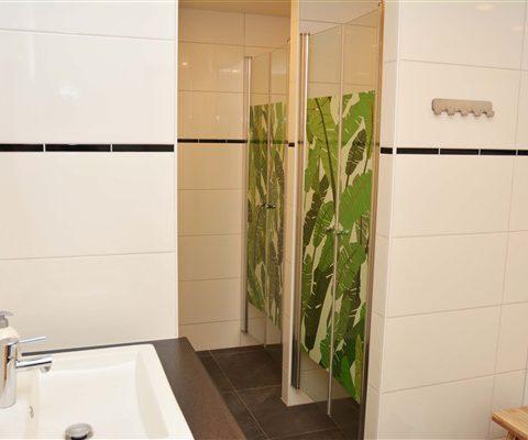 Groepshuis voor 18 personen met badkamers en sauna.